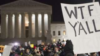 Demonstrators protest against President Trump outside the US Supreme Court