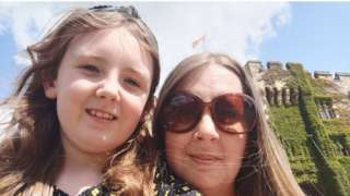 Hannah Nash and her daughter Isla outside a castle