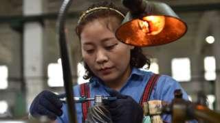 A woman working at a gear factory in Taizhou, East China's Jiangsu province.