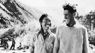 Smiling victors Sherpa Tenzing (Left) and Edmund Hillary at their camp after their return from Everest.