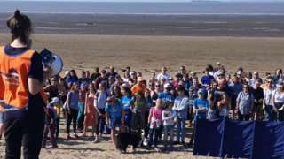 Volunteers on Sand Bay ready for the beach clean