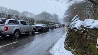 Cars parked on a road near Rivington Pike