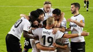 Valencia's players celebrate scoring against Real Madrid
