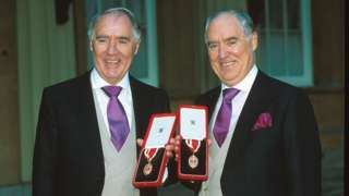 David (right) and Frederick Barclay receiving their knighthoods.