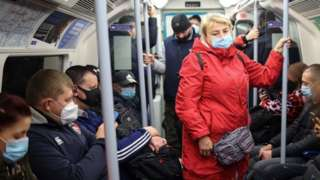 Passengers on a London Tube train
