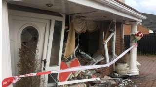 Damage to the front of the house that was rammed with a car