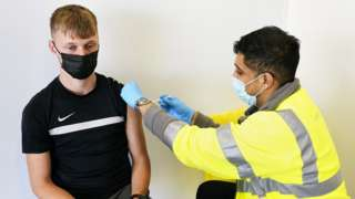 Young person being vaccinated