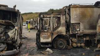 Burnt out refuse lorries