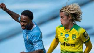 Manchester City's Raheem Sterling and Todd Cantwell of Norwich