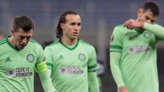 Celtic's Callum McGregor, Diego Laxalt and Nir Bitton are left disappointed in Milan