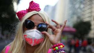 """A woman takes part in a protest calling for the impeachment of Brazil""""s President Jair Bolsonaro and against his handling of the coronavirus disease (COVID-19) pandemic, in Rio de Janeiro, Brazil, July 3, 2021"""