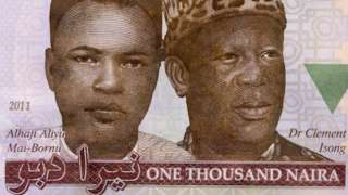 A close up of the 1,000 naira note with its value written in Roman and Arabic script
