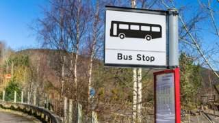 A bus stop sign in the countryside