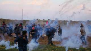 Tear-gas canisters fired by Israeli troops towards Palestinians during a protest on the Gaza-Israel border fence in the southern Gaza Strip on 22 February 2019