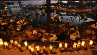 Candles are lit in Santa Barbara Harbour at a makeshift memorial for victims of the Conception boat fire