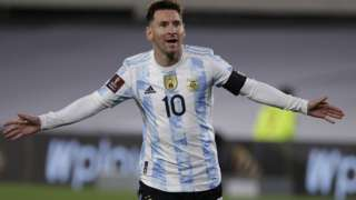 Lionel Messi celebrates with his arms stretched out wide