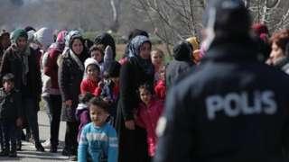 Turkish police watch migrants near Greek border, 29 Feb 20