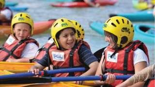 Children in canoes