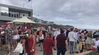 Young revellers at the Christmas backpacker party in Bronte