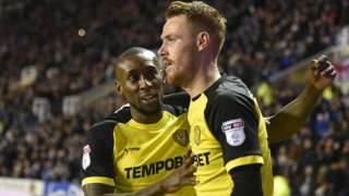 Burton's players celebrate victory over Reading