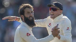 England all-rounder Moeen Ali celebrates with Joe Root after taking a wicket against India