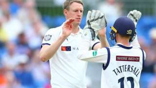 Yorkshire skipper Steve Patterson celebrates the first of his three wickets with keeper Jonny Tattersall