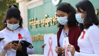 Myanmar department of agriculture workers in the capital wear red ribbons in protest against the coup, 4 February