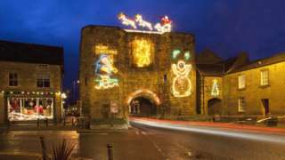 The tower lit up in Christmas lights