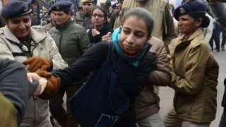 Police detain a woman at a demonstration against Indias new citizenship law in New Delhi on December 19, 2019.