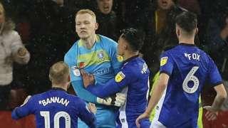 Sheff Wed celebrate Cameron Dawson's penalty save