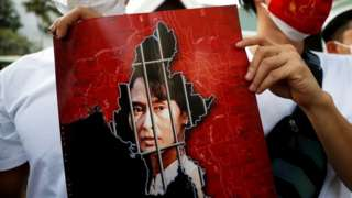 Picture of Aung San Suu Kyi's face behind bars