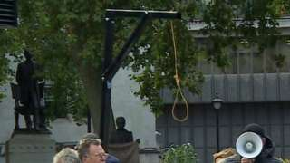 Protesters with gallows
