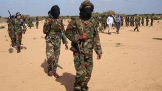 Somali Al-Shebab fighters gather on February 13, 2012 in Elasha Biyaha, in the Afgoei Corridor, after a demonstration to support the merger of Al-shebab and the Al-Qaeda network.
