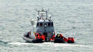 A Border Force vessel intercepts a group of people thought to be migrants in a small boat off the coast of Dover in Kent in September 2021