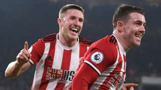 John Lundstram and John Fleck celebrate with Sheffield United
