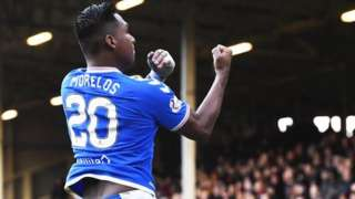Alfredo Morelos gestures to the Motherwell support