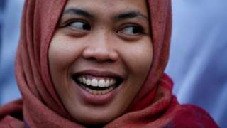 Siti Aisyah, who was previously a suspect in the murder case of North Korean leader's half brother Kim Jong Nam, laughs during a news conference