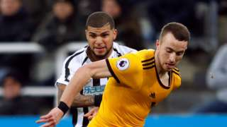 Newcastle United's DeAndre Yedlin fouls Wolverhampton Wanderers' Diogo Jota