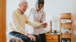 Older man receiving care