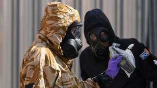 Police and army in hazmat suits in Salisbury in 2018