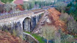 Bridge wall collapse