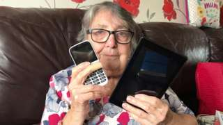Brenda from Bristol with her phone and tablet