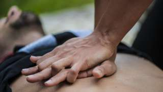Man giving chest compressions or CPR