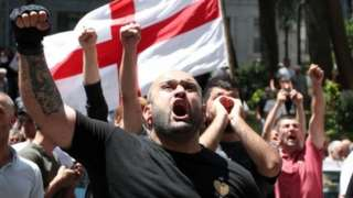 Anti-LGBT protesters shout during a demonstration in Tbilisi