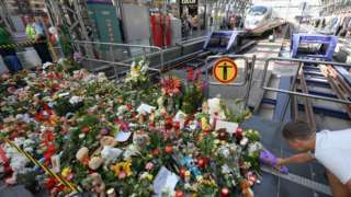 A makeshift memorial for an eight-year-old boy who died when a man pushed him and his mother in front of a train