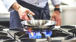Chef using gas hob
