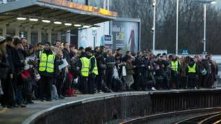Passengers waiting for a train during a strike