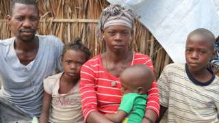 A couple who fled militants in northern Mozambique with their three children - their eldest son was beheaded