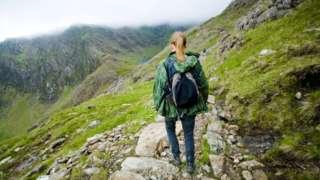 Woman walking on Snowdon