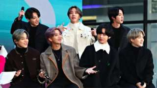 BTS pose on stage